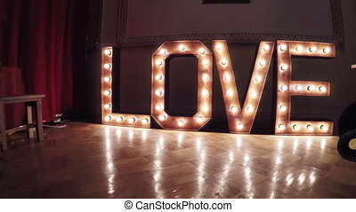 Inscription Burning Love - Place for photo shoots and...