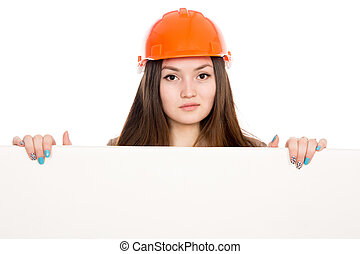 Woman builder in a helmet with a blank banner. Asian young...