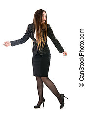 Business woman in full growth is looking back. Asian model...