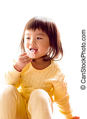 Lovely Asian baby sit and suck pacifier