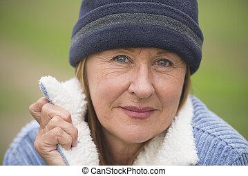 Happy confident mature woman jacket and bonnet