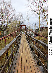 Suspension bridge across the Volga River in the village of...