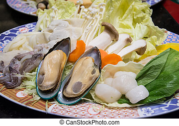 Mussels with mixed chopping vegetable on dish ,suki yaki...