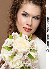 Close-up portrait of a beautiful woman with flowers. -...