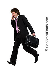Running and speaking by phone - Business man running with a...