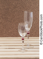 empty wine glasses on a table on a wooden