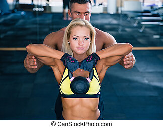 Woman workout with kettle ball in gym - Woman workout with...