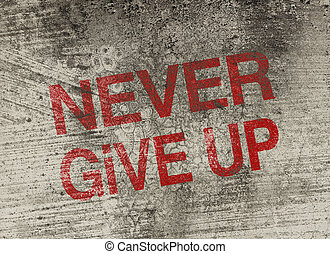 Never give up concept text is painted on old fashion wall