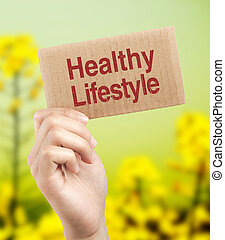 Healthy lifestyle brown card is holden by woman hand with...