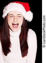 Pretty woman wearing santa hat - A pretty young woman...