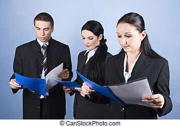 Business team reading - Business team people holding blue...
