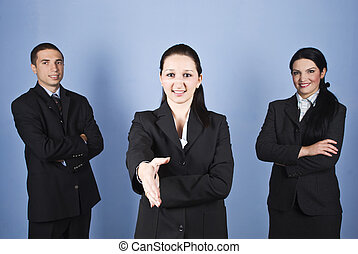 Wecome business gesture - Business women giving welcome...