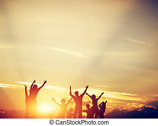 Happy friends, family jumping together at sunset. - Happy...