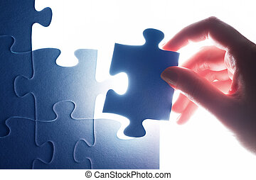 Completing the last piece of jigsaw puzzle. Solution,...