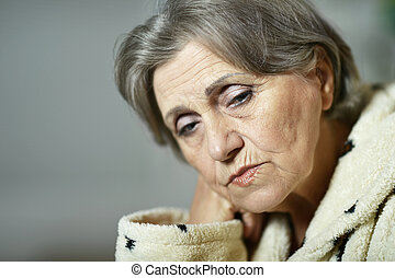 old woman with a handkerchief at home
