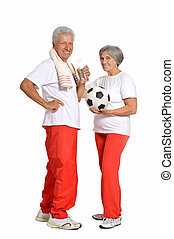 Senior couple exercising with ball and thumbs up on a white...