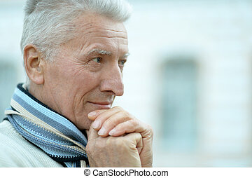 senior man thinking - close-up portrait of a senior man...