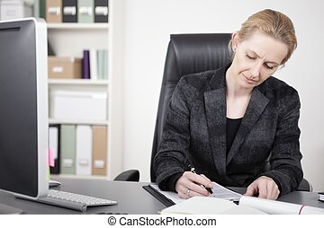 Adult Businesswoman Writing on Top of her Desk - Close up...