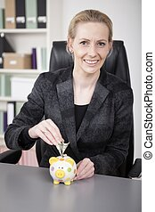 Smiling Businesswoman Saving Money to Piggy Bank - Close up...