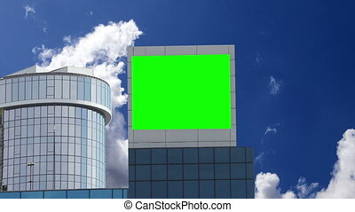 Advertising on the building, green