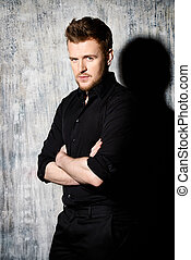 mature man - Fashionable man in black shirt posing at studio...