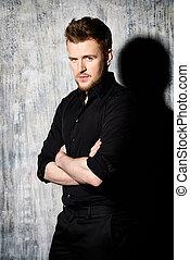mature man - Fashionable man in black shirt posing at...