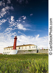 Red Lighthouse - Lighthouse in evening sunlight in...