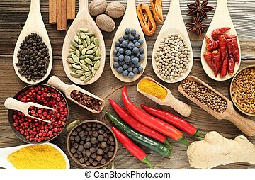 Spices - Spices and herbs in metal bowls and wooden spoons...