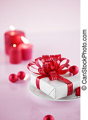 gift as table decorations - White present with red ribbons...