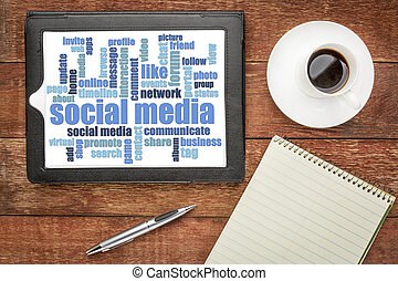 social media word cloud on digital tablet - top view on a...