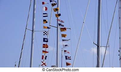 nautical flags - Nautical flags waving. Blue sky. Summer....