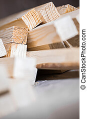 Wooden beams and planks. Lumber stacked at construction site