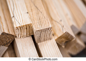 Wooden beams and planks Lumber stacked at construction site