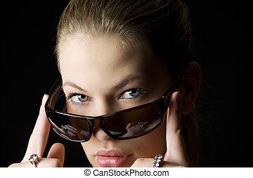 looking behind sunglasses