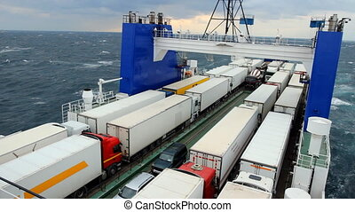 big cargo ferry during a storm - sea ferry transports trucks...