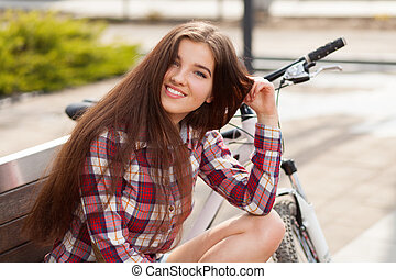 Young woman on a bicycle trip