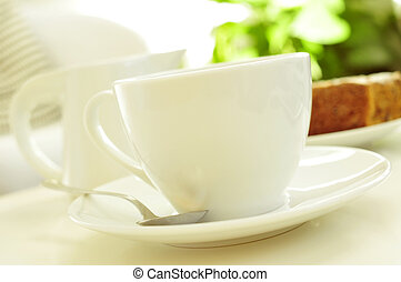 coffee or tea and cake - closeup of a white porcelain cup...