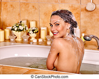 Woman relaxing at bubble bath. - Woman relaxing at water in...