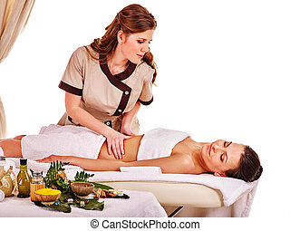 Woman getting spa therapy outdoor. - Young woman getting...