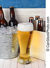 Beer Still Life - Beer still life with a tall glass a six...