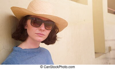 woman with hat and sun glasses - A beatiful woman with glass...