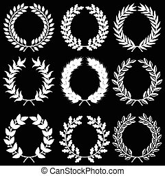 White laurel wreaths on black background set - Vector...