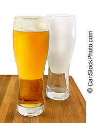 Glasses of light beer and empty glass - Bright light beer...