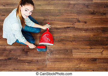 Cleaning woman sweeping wooden floor - Cleanup housework...