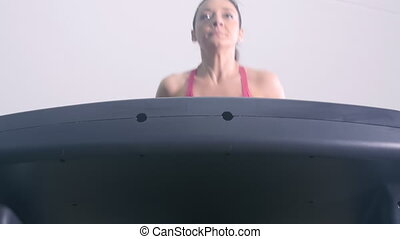 fit woman running on treadmill - wellness workout,healthy...