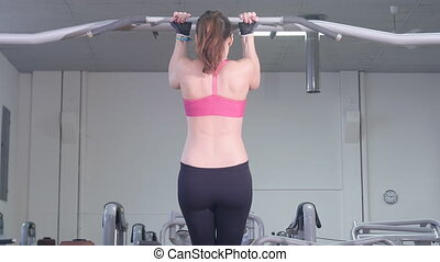 woman doing pull ups - sport fitness,young healthy woman...
