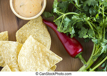 Tortilla chips - Tortilla chips and dip on a wood
