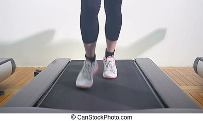 woman running on treadmill - woman legs running on treadmill...