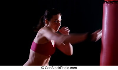 woman working out boxing kicking - sport fitness,woman...