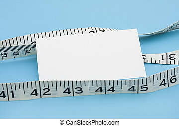 Measuring Success - A white measuring tape with a blank note...
